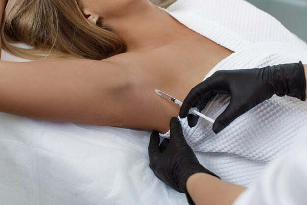 doctor-makes-intramuscular-injections-botulinum-toxin-underarm-area-against-hyperhidrosis_302872-153
